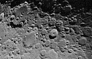 In alto a sinistra, il cratere Magino.